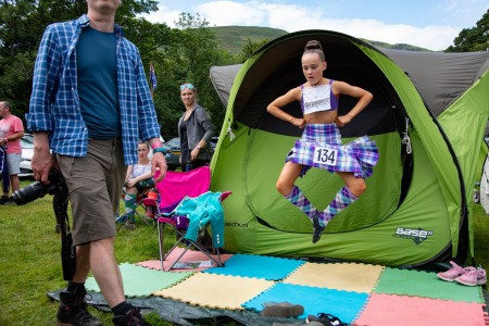Young Highland Dancer warms up for competition